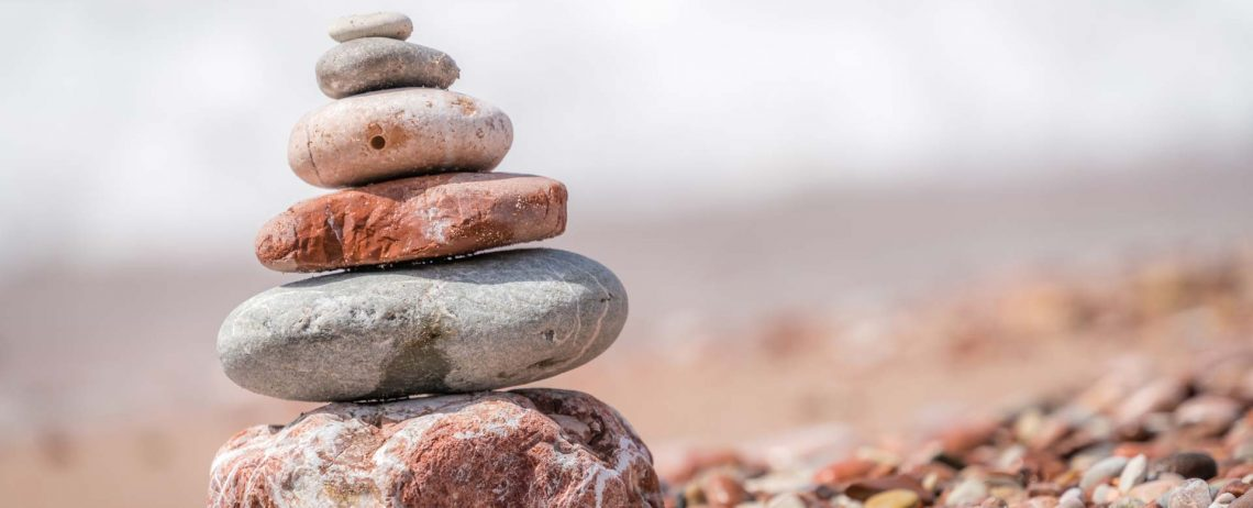 zen-balanced-small-pile-of-stacked-stones-GR5MQKW.jpg